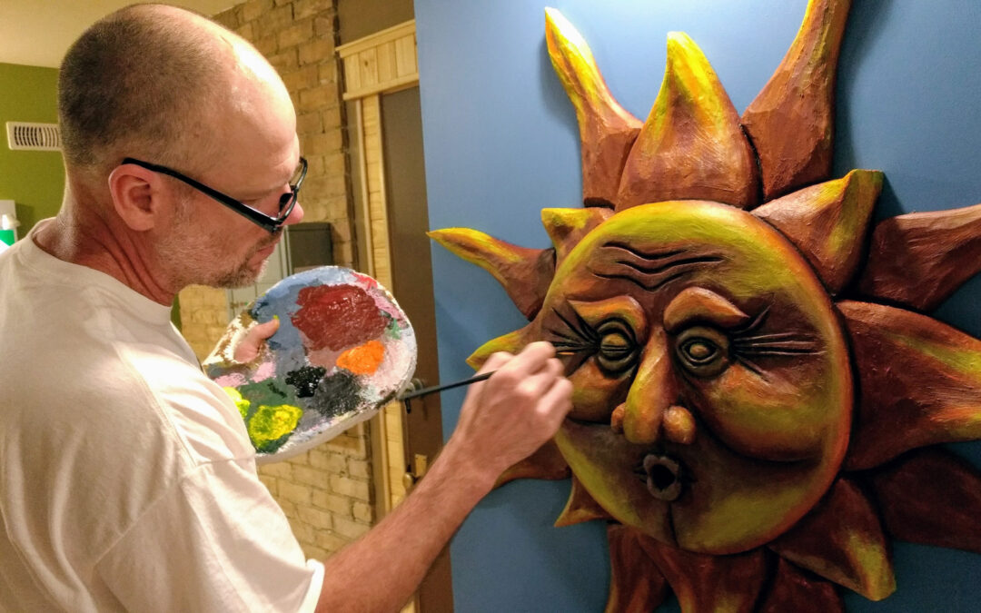 tony hale paints a large sun sculpture on the wall